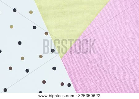 Abstract Pink, Yelow And White Paper Background With Black And Brown Polka Dots.