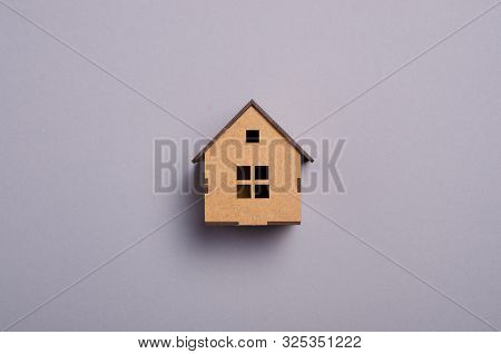 Wooden House Model On Gray Background, Top View