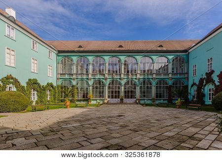 Dacice, Czech Republic - September 29 2019: View Of Square Courtyard And Green Facade Of A State-own
