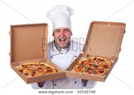 Male Chef Holding Open Two Boxes Of Pizza