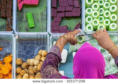 Top View Of Unidentified Vendor At The Food Stall In Kota Kinabalu City Food Market, Sabah, Malaysia