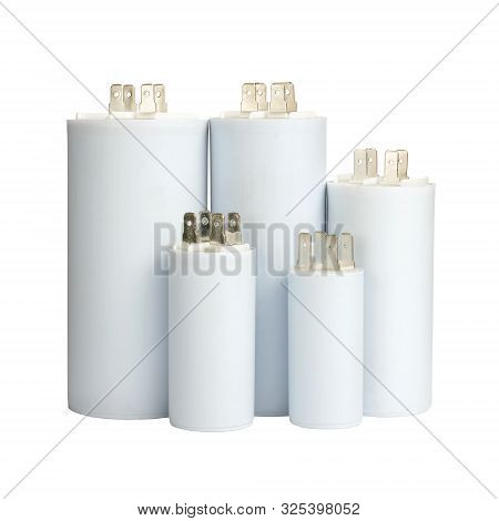Group White Electrolytic Capacitors In Row Isolated On White Background, Closeup View