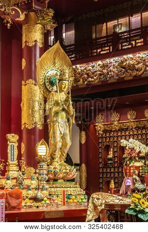 Singapore - March 22, 2019: Buddha Tooth Relic Temple In Chinatown. Closeup Of Bodhisattva On Side O