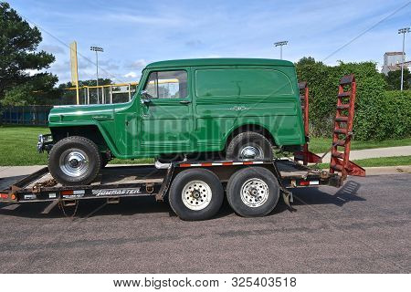 Yankton, South Dakota, August 16, 2019: A Restored 1950 Willys Jeep Hauled On A Trailer Will Be Disp