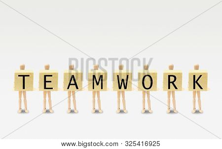Business Teamwork Concept : Group Of Wooden Figures Mannequin Standing And Holding Wooden Blocks In