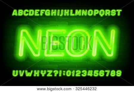 Neon Alphabet Font. Green Neon Light Letters And Numbers On Brick Wall Background. Stock Vector Type