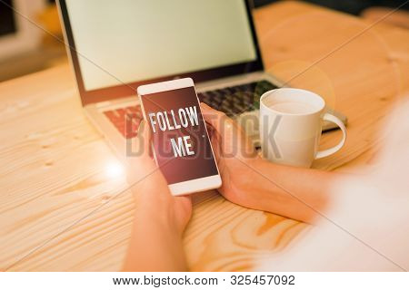 Handwriting text writing Follow Me. Concept meaning Inviting a demonstrating or group to obey your prefered leadership woman laptop computer smartphone mug office supplies technological devices. poster