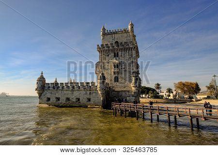Lisbon, Lisbon, Portugal - December 8 2018: Famous Belem Tower On Lisbon Riverside With People Touri