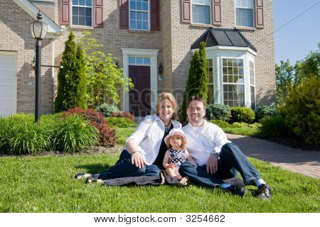 Family In Front Of House