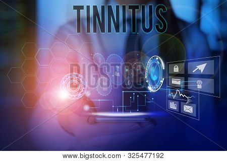 Conceptual hand writing showing Tinnitus. Business photo text A ringing or music and similar sensation of sound in ears Woman wear work suit presenting presentation smart device. poster