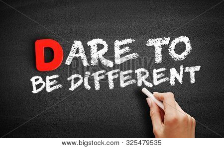 Dare To Be Different Text On Blackboard, Business Concept Background