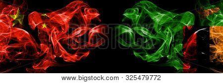China Vs Zambia, Zambian Smoke Flags Placed Side By Side. Thick Colored Silky Smoke Flags Of Chinese