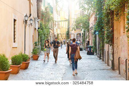 Rome, Italy - September 17, 2019: People Walking In Trastevere Neighborhood In Rome, Italy.