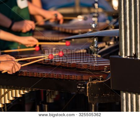 Several Sideline Percusionists Performing At An Outddors Rehearsal