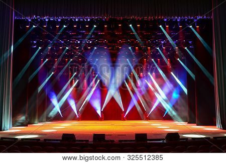 Illuminated Empty Concert Stage With Multicolor Light And Stage Fog