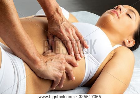 Physiotherapist Applying Pressure With Thumbs Under Woman's Thorax.