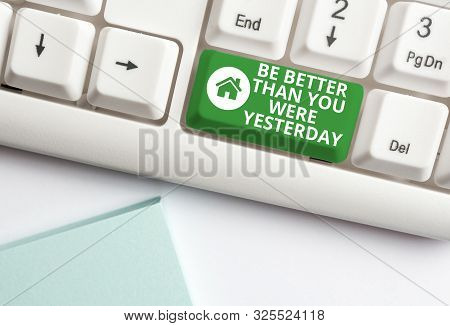 Handwriting text writing Be Better Than You Were Yesterday. Concept meaning try to improve yourself everyday White pc keyboard with empty note paper above white background key copy space. poster