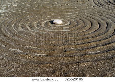 Circular Lines With Stone In Feng Shui Garden