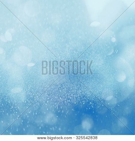 Christmas Glowing Blue Background. Christmas Lights. Blue Holiday New Year Abstract Glitter Defocuse