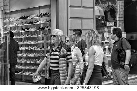 Shopping. People Walk In The City. Exterior Of A Shoe Store. Shop Windows. Urban Landscape. Black An