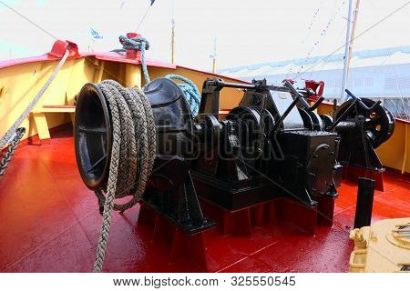 Tugboat Winch And Ropes Situated At The Prow End Of The Ship