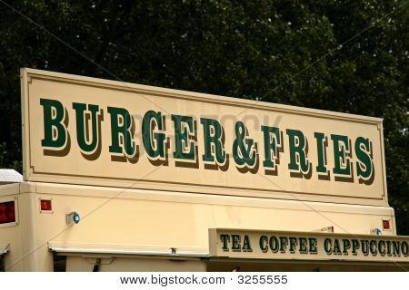 Burger And Fries Sign Above Fast Food Van
