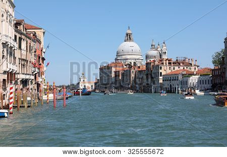 Venice And The Grand Canal With Big Dome Of Madonna Della Salute And Many Boats