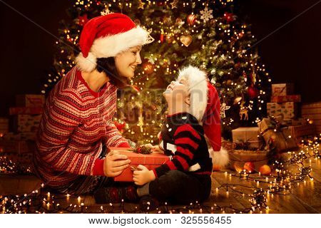 Christmas Family Open Present Gift Box, Parents And Kid In New Year Night Eve, Decorated Xmas Tree L