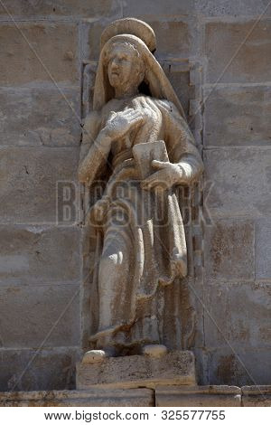 PAG, CROATIA - AUGUST 03, 2013: Virgin Mary, statue on the portal of Church of the Assumption of the Virgin in Pag, Croatia