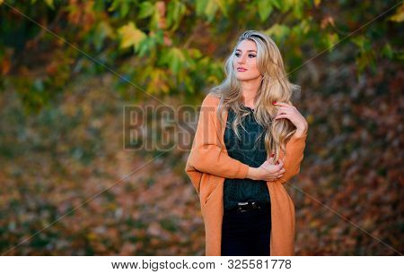 Comfortable Outfit. Girl Adorable Blonde Posing In Warm And Cozy Outfit Autumn Nature Background Def