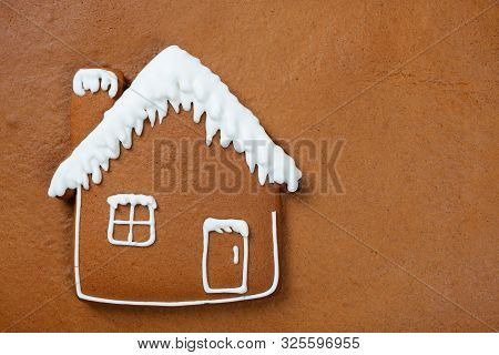 The Hand-made Eatable Gingerbread House On Gingerbread Background