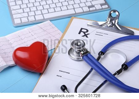 Medical Stethoscope And Red Heart Lying On Cardiogram Chart Closeup. Medical Help, Prophylaxis, Dise