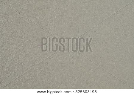 Grey Soft Leather For The Background. Natural Leather Texture Space For Text On The Gray Background