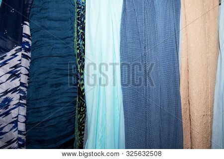Multicolored Fabric Scarves, Shawls, Stoles, In A Vintage Store. Blue And Beige