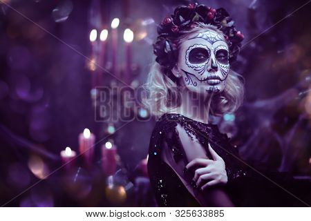 Day of The Dead. Charming and dangerous Calavera Catrina in an old abandoned house. Sugar skull girl. Dia de los muertos. Halloween.