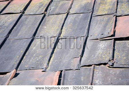 Old Sheets Of Iron On The Roof Of The House, The Destruction Of The Roof Of The Building, A Dilapida