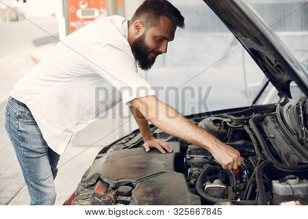 Handsome Man Checks The Engine In His Car