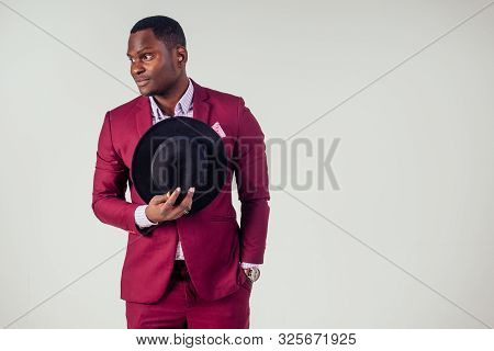 Retro Style Well Dressed African American Business Man Model In Red Suit And Black Hat In Studio On
