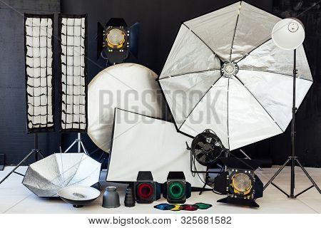 Photo Studio Equipment Flash Accessories Photographer On Black Background