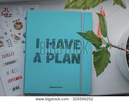 Photography Of A Bright Blue Planner With The Phrase I Have A Plan. Photography Of Notebooks And Pla