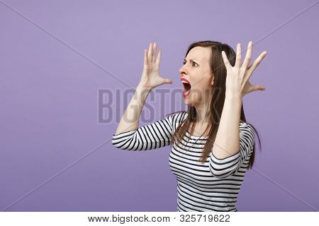 Angry Crazy Young Woman In Casual Striped Clothes Posing Isolated On Violet Purple Background Studio