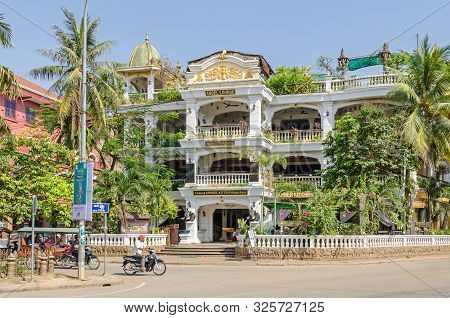 Siem Reap, Cambodia - April 12, 2018:  Boulevard Sivutha With The Terrasse Des Elefants Hotel And Re