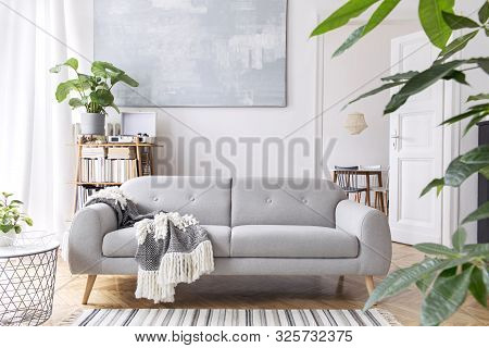 Stylish Scandinavian Open Space With Design Furniture, Plants, Sofa And Personal Accessories. Modern