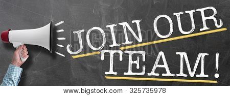 Hand Holding Megaphone Or Bullhorn Against Chalkboard With Text Join Our Team, Job Offer Or Vacancy