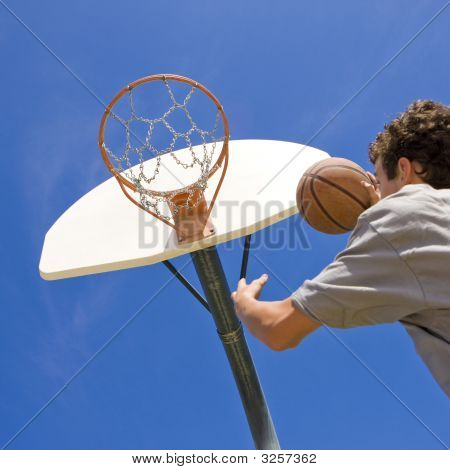 Basketball Player Jumps For Hoop