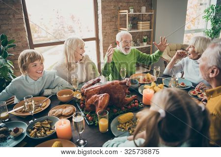 Photo Of Full Family Reunion Gathering Sit Feast Dishes Chicken Table Communicating Fall November Au
