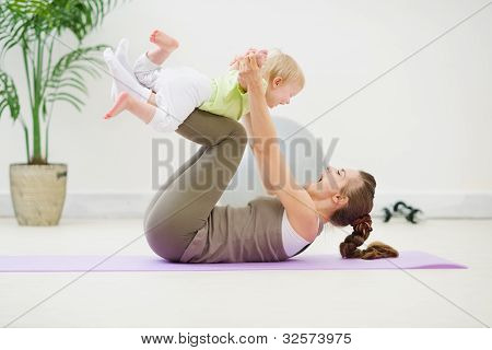 Healthy Mother And Baby Making Gymnastics