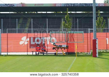 Mainz, Germany - September 22: Two Paramedics Sitting On The Sidelines At A Game Of Junior National