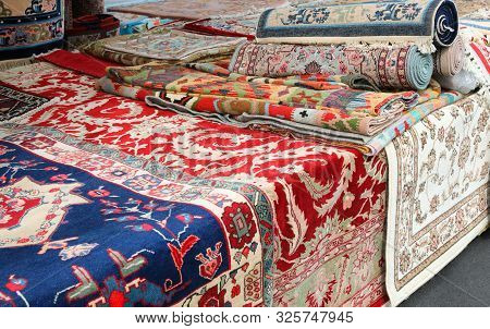 Market Stall Specializing In The Sale Of Precious Handmade Oriental Rugs