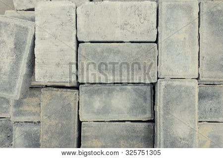 Pavement Tile Folded For The Reconstruction Of A Walkway. Paving Blocks The Main Paving Material For